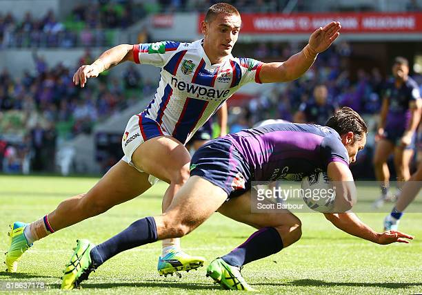 Cooper Cronk of the Storm scores a try during the round five NRL match between the Melbourne Storm and the Newcastle Knights at AAMI Park on April 2...