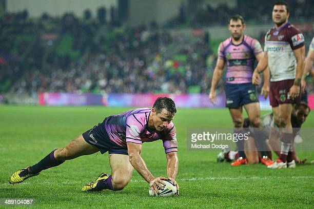 Cooper Cronk of the Storm scores a try during the round nine NRL match between the Melbourne Storm and the ManlyWarringah Sea Eagles at AAMI Park on...