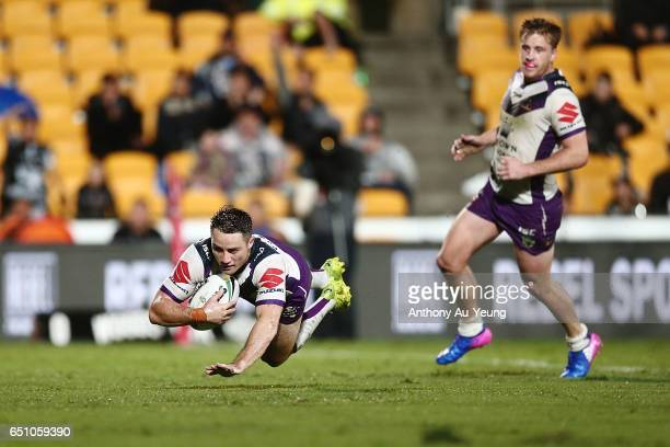 Cooper Cronk of the Storm scores a try during the round two NRL match between the New Zealand Warriors and the Melbourne Storm at Mt Smart Stadium on...
