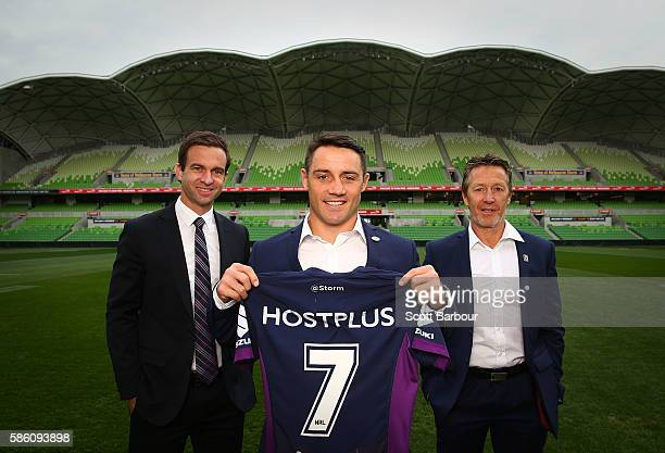 Cooper Cronk of the Storm Storm head coach Craig Bellamy and Storm CEO Dave Donaghy pose during a Melbourne Storm NRL media opportunity at AAMI Park...