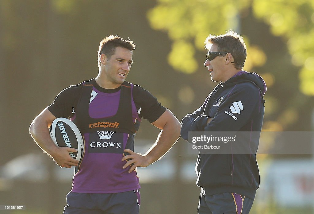 Cooper Cronk of the Storm talks with Storm coach Craig Bellamy during a Melbourne Storm NRL training session at Gosch's Paddock on February 11, 2013 in Melbourne, Australia.
