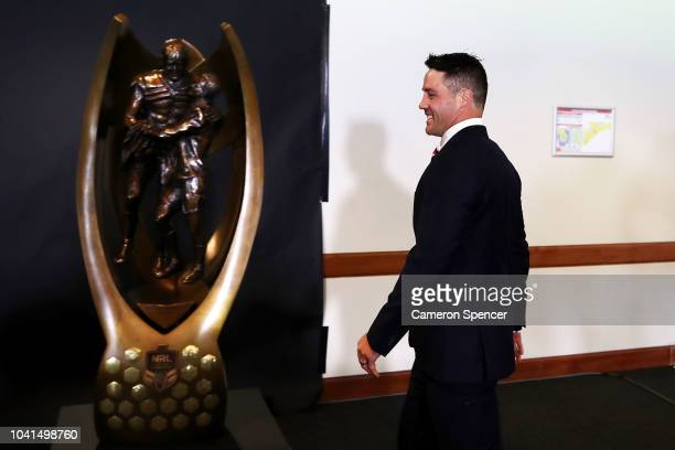 Cooper Cronk of the Sydney Roosters walks past The ProvanSummons Trophy during the 2018 NRL Grand Final press conference at the Sydney Cricket Ground...