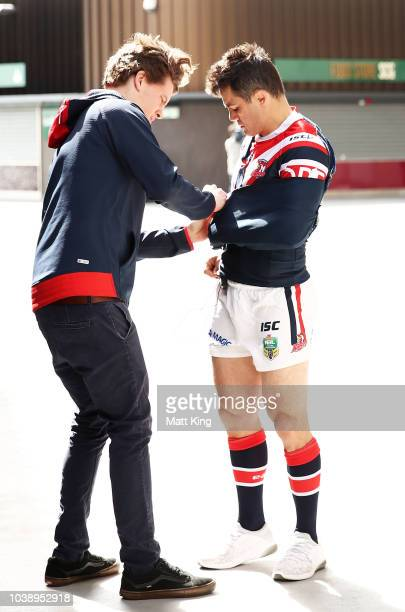 Cooper Cronk prepares to speak to the media with the arm in a sling during a Sydney Roosters NRL media opportunity at the Sydney Cricket Ground on...