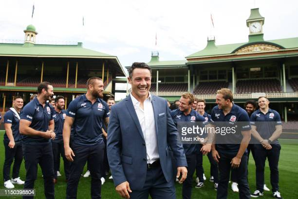 Cooper Cronk sposes in front of his Roosters team mates during a Sydney Roosters NRL press conference at the Sydney Cricket Ground on May 20, 2019 in...