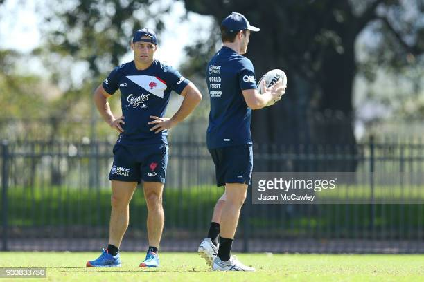 Cooper Cronk talks to Luke Keary of the Roosters during a Sydney Roosters NRL training session at Kippax Lake on March 19 2018 in Sydney Australia