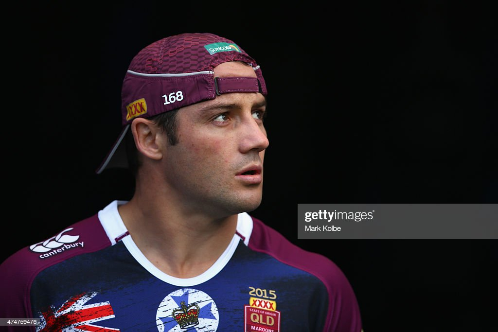 Cooper Cronk walks out to the field for a Queensland Maroons State of Origin training session at ANZ Stadium on May 26, 2015 in Sydney, Australia.