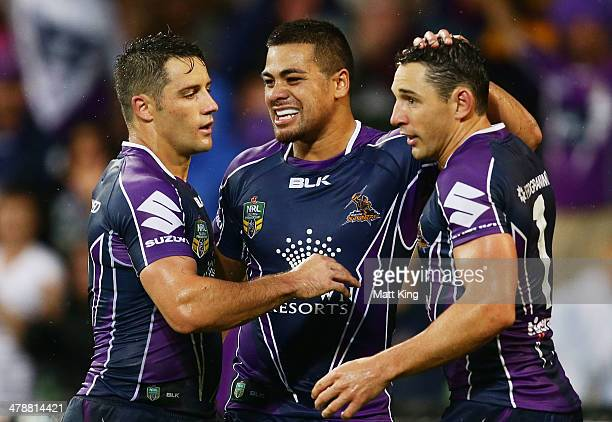 Cooper Cronk Young Tonumaipea and Billy Slater celebrate winning the round two NRL match between the Melbourne Storm and the Penrith Panthers at AAMI...