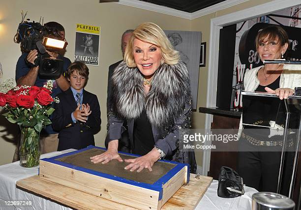 Cooper Endicott and television personality Melissa Rivers watch as television personality and actress Joan Rivers places her hand prints on location...