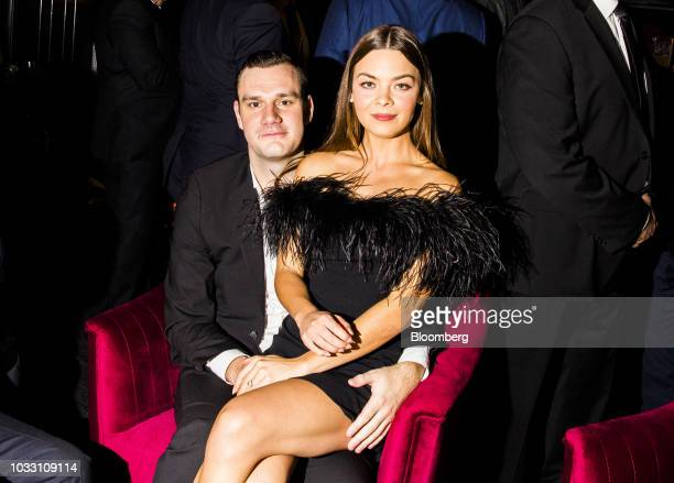 Cooper Hefner chief creative officer of Playboy Enterprises Inc and son of the late Hugh Hefner and his fiancee actress Scarlett Byrne sit for a...