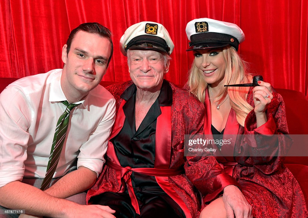 Cooper Hefner, Hugh Hefner and Crystal Hefner attend Playboy Mansion's Annual Halloween Bash at The Playboy Mansion on October 25, 2014 in Los Angeles, California.