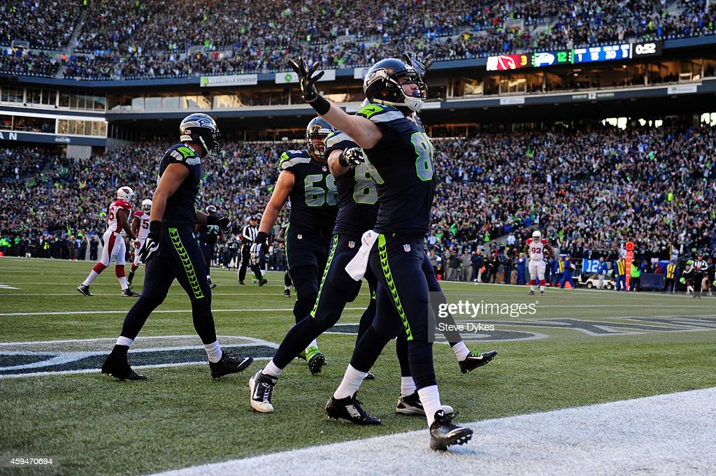 Cooper Helfet #84 of the Seattle Seahawks celebrates after catching a 20 yard touchdown pass by Russell Wilson #3 in the third quarter against the Arizona Cardinals during their game at CenturyLink Field on November 23, 2014 in Seattle, Washington.