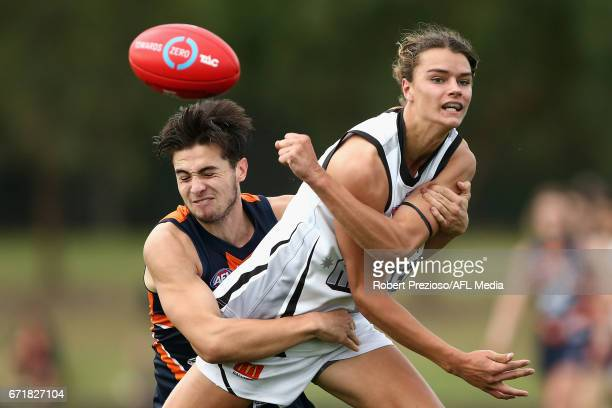 Cooper Henson of the Rebels handballs during the round four TAC Cup match between the Northern Knights and the Murray Bushrangers at RAMS Arena on...