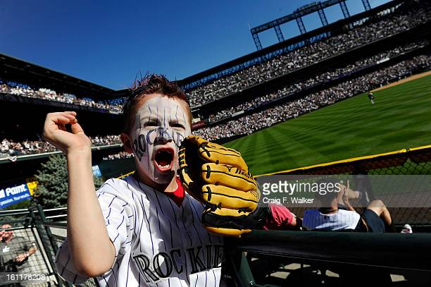 Cooper Hertz cheers as the Rockies tie the score 66 in the bottom of the 7th inning during the Colorado Rockies Opening Day game against the Arizona...