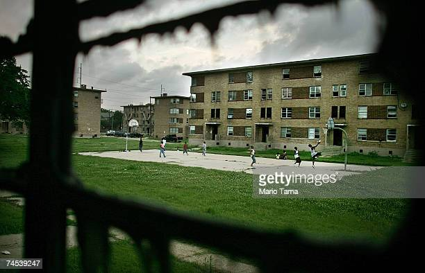 Cooper housing project residents play basketball in front of storm damaged apartments in the complex June 7, 2007 in New Orleans, Louisiana. Before...