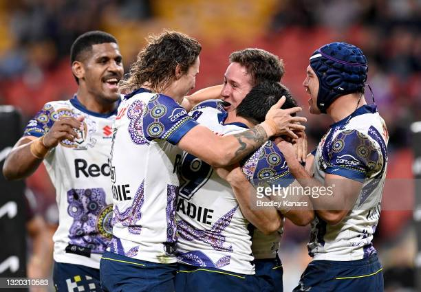 Cooper Johns of the Storm is congratulated by team mates after scoring a try during the round 12 NRL match between the Brisbane Broncos and the...
