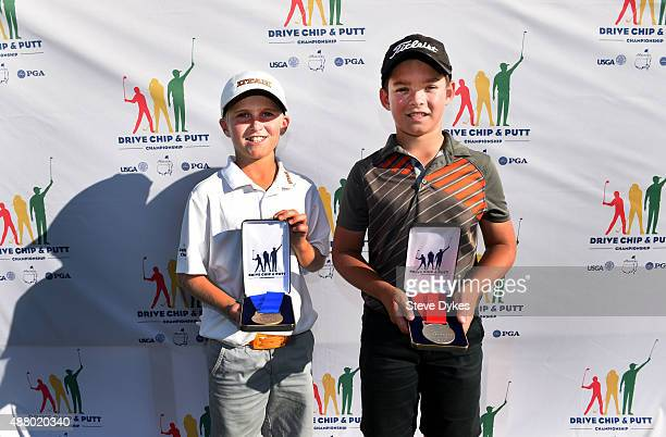 R Cooper Jones and Jackson Koivun pose with their trophies after placing first and second in the Overall competition in the Boys 1011 yr old Drive...