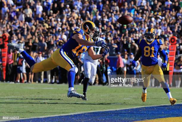 Cooper Kupp is unable to catch a pass as Gerald Everett of the Los Angeles Rams looks on during the second half of a game against the Seattle...