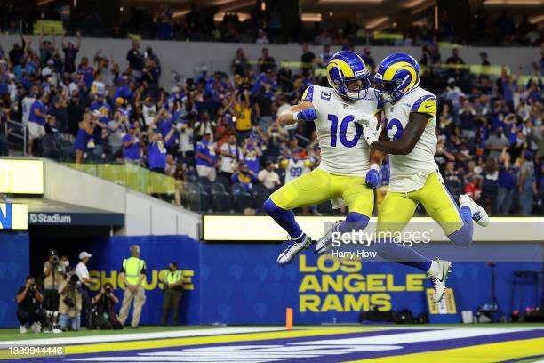 Cooper Kupp of the Los Angeles Rams celebrates a touchdown with Van Jefferson following a touchdown during the second half against the Chicago Bears...