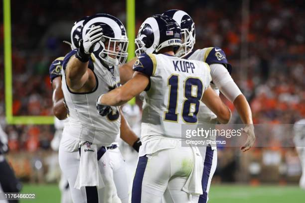 Cooper Kupp of the Los Angeles Rams celebrates his third quarter touchdown with teammates while playing the Cleveland Browns at FirstEnergy Stadium...