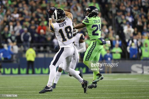 Cooper Kupp of the Los Angeles Rams completes a pass against Jamar Taylor of the Seattle Seahawks in the fourth quarter during their game at...