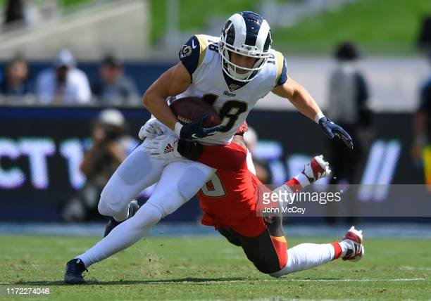 Cooper Kupp of the Los Angeles Rams is brought down by MJ Stewart of the Tampa Bay Buccaneers in the first quarter at Los Angeles Memorial Coliseum...