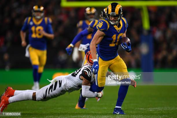 Cooper Kupp of the Los Angeles Rams is tackled by Jessie Bates of the Cincinnati Bengals during the NFL London Games series match between the...