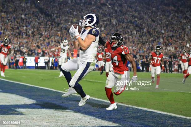 Cooper Kupp of the Los Angeles Rams makes a catch for a touchdown in front of cornerback Brian Poole of the Atlanta Falcons during the NFC Wild Card...