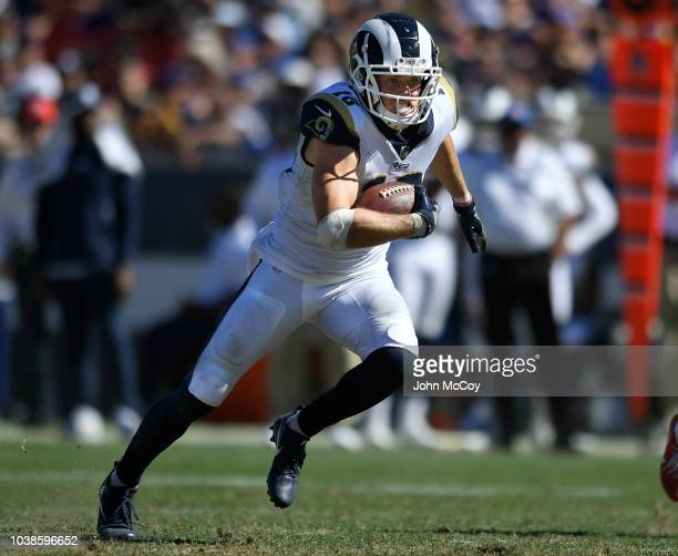 Cooper Kupp of the Los Angeles Rams runs for yardage against the Arizona Cardinals in the first half at Los Angeles Memorial Coliseum on September 16...