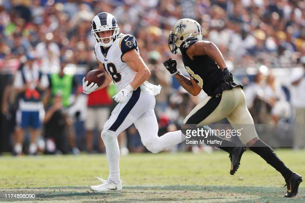 Cooper Kupp of the Los Angeles Rams runs on a 67yard reception during the fourth quarter as Marshon Lattimore of the New Orleans Saints attempts to...