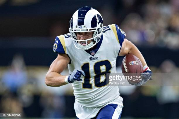 Cooper Kupp of the Los Angeles Rams runs the ball after catching a pass during a game against the New Orleans Saints at MercedesBenz Superdome on...