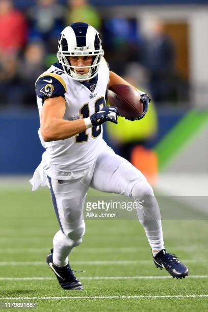 Cooper Kupp of the Los Angeles Rams runs with the ball after a short pass reception during the game against the Seattle Seahawks at CenturyLink Field...
