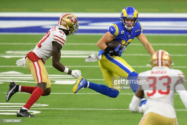 Cooper Kupp of the Los Angeles Rams runs with the ball during the fourth quarter against the San Francisco 49ers at SoFi Stadium on November 29, 2020...