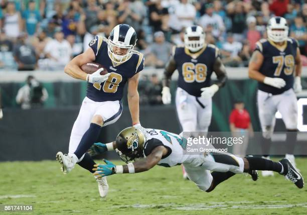 Cooper Kupp of the Los Angeles Rams runs with the football past Aaron Colvin of the Jacksonville Jaguars in the second half of their game at EverBank...