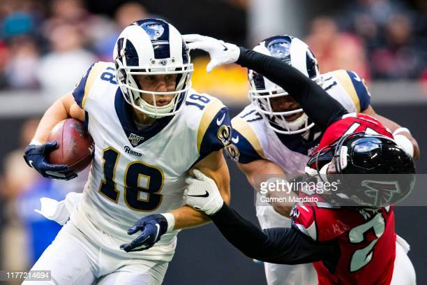 Cooper Kupp of the Los Angeles Rams rushes in front of defender Damontae Kazee of the Atlanta Falcons during the first half of a game at MercedesBenz...