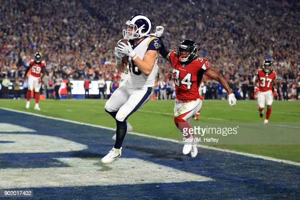 Cooper Kupp of the Los Angeles Rams scores a touchdown during the NFC Wild Card Playoff Game against the Atlanta Falcons at the Los Angeles Coliseum...