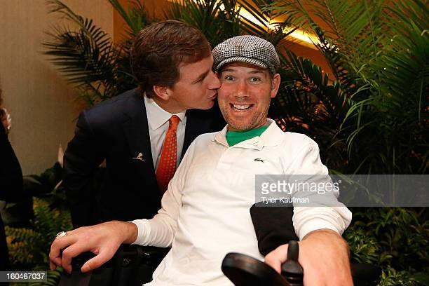 Cooper Manning and former New Orleans Saint Steve Gleason attend the 2013 Legends For Charity Dinner Honoring Archie Manning at the Hyatt Regency New...