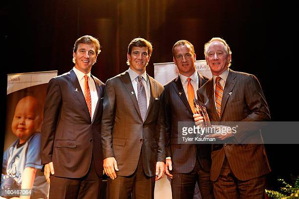 Cooper Manning Eli Manning Peyton Manning and father Archie Manning attend the 2013 Legends For Charity Dinner where Archie was honored at the Hyatt...