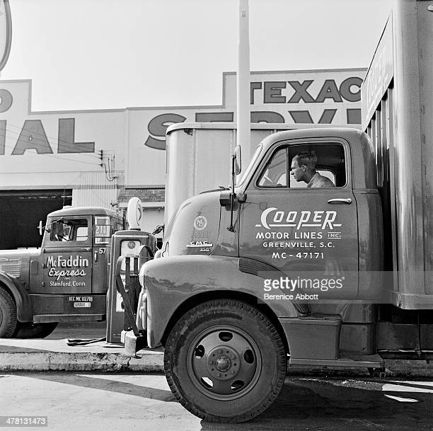 Cooper Motor Line truck and driver at Texaco Service United States 1954