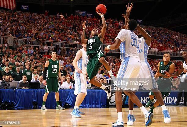 J Cooper of the Ohio Bobcats drives for a shot attempt in the second half against John Henson of the North Carolina Tar Heels during the 2012 NCAA...