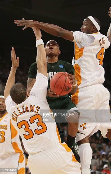 J Cooper of the Ohio Bobcats heads for the net as Brian Williams and Wayne Chism of the Tennessee Volunteers defend during the second round of the...
