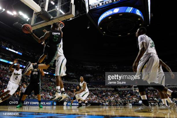 J Cooper of the Ohio Bobcats looks to pass the ball against the South Florida Bulls during the third round of the 2012 NCAA Men's Basketball...