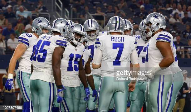 Cooper Rush of the Dallas Cowboys huddles with the team during a preseason football game agaisnt the Arizona Cardinals at ATT Stadium on August 26...