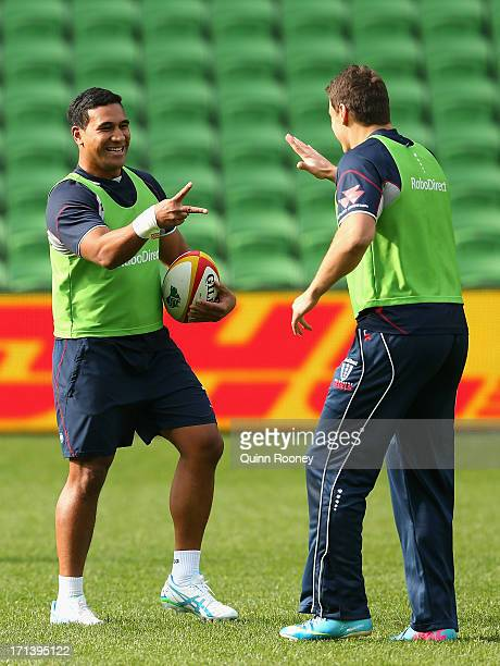 Cooper Vuna and Mitch Inman of the Rebels play rock paper scissors during a Melbourne Rebels Super Rugby captain's run at AAMI Park on June 24 2013...