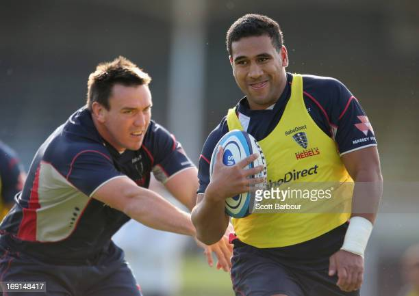 Cooper Vuna beats the tackle of Nic Henderson during a Melbourne Rebels Super Rugby Training Session at Visy Park on May 21 2013 in Melbourne...