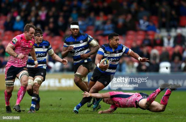 Cooper Vuna of Bath is tackled by Stuart Townsend of Exeter Chiefs during the AngloWelsh Cup Final between Bath Rugby and Exeter Chiefs at Kingsholm...
