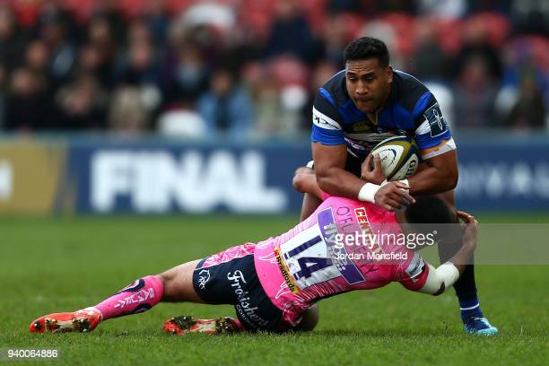 Cooper Vuna of Bath is tackled by Tom O'Flaherty of Exeter Chiefs during the AngloWelsh Cup Final between Bath Rugby and Exeter Chiefs at Kingsholm...