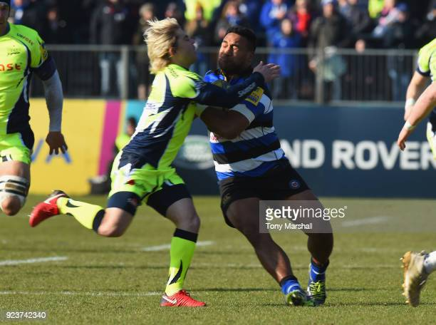 Cooper Vuna of Bath Rugby is tacked by Faf De Klerk of Sale Sharks during the Aviva Premiership match between Bath Rugby and Sale Sharks at...