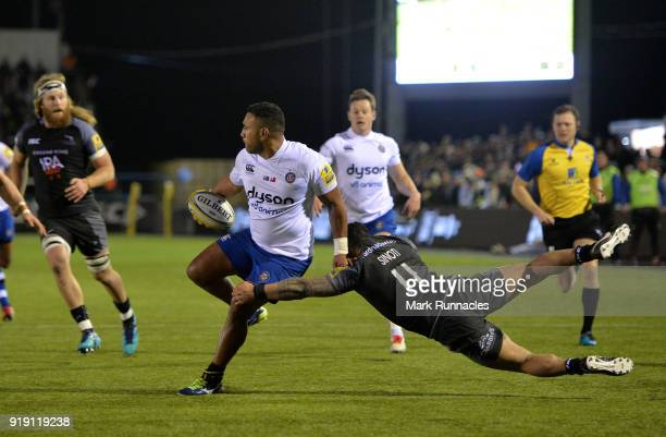 Cooper Vuna of Bath Rugby is tackled by Sinoti Sinoti of Newcastle Falcons during the Aviva Premiership match between Newcastle Falcons and Bath...