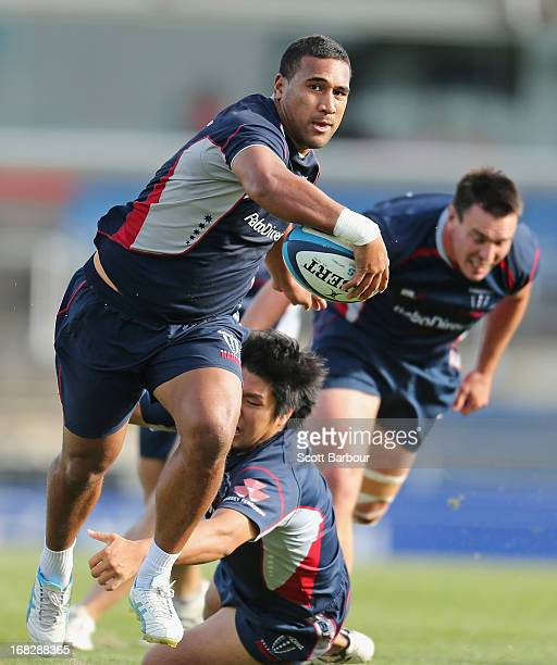 Cooper Vuna of the Rebels beats the tackle of Shota Horie as he runs with the ball during a Melbourne Rebels Super Rugby training session at Visy...