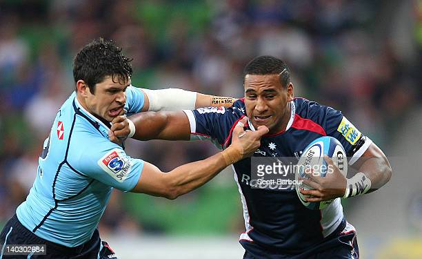 Cooper Vuna of the Rebels is tackled by Tom Carter of the Waratahs during the round two Super Rugby match between the Rebels and the Waratahs at AAMI...